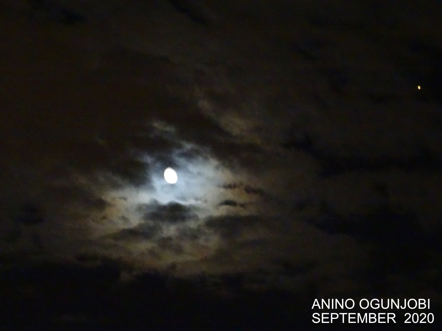 Waning Gibbous Moon in the Night Clouds with Planet Mars Close By